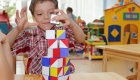 boy in a kindergarten plays with cubes